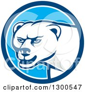 Clipart Of A Cartoon Polar Bear Mascot In A Blue And White Circle Royalty Free Vector Illustration by patrimonio