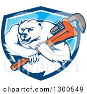Clipart Of A Cartoon Polar Bear Plumber Mascot Wielding A Monkey Wrench In A Blue And White Shield Royalty Free Vector Illustration by patrimonio