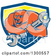 Clipart Of A Cartoon Roaring Angry Grizzly Bear Mechanic Mascot Carrying A Giant Wrench In A Blue White And Yellow Shield Royalty Free Vector Illustration