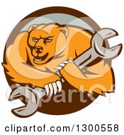Clipart Of A Cartoon Roaring Angry Grizzly Bear Mechanic Mascot Carrying A Giant Wrench In A Circle Royalty Free Vector Illustration