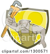 Clipart Of A Cartoon Bulldog Plumber Holding Out A Monkey Wrench And Emerging From A Green White And Yellow Shield Royalty Free Vector Illustration