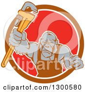Clipart Of A Cartoon Retro Tough Gorilla Plumber Man Punching With A Monkey Wrench In A Brown White And Red Circle Royalty Free Vector Illustration by patrimonio