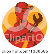 Clipart Of A Retro Red Male Worker Holding A Spanner Wrench In A Yellow Circle Royalty Free Vector Illustration