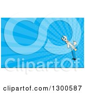 Clipart Of A Cartoon Male Mechanic Holding A Wrench And Blue Rays Background Or Business Card Design Royalty Free Illustration