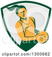 Clipart Of A Retro Female Netball Player Emerging From A Green White And Gray Shield Royalty Free Vector Illustration by patrimonio