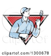 Clipart Of A Retro Male Worker Holding A HDMI Cable And Emerging From A Black White And Red Rays Triangle Royalty Free Vector Illustration