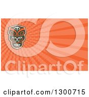 Clipart Of A Retro Maori Mask And Orange Rays Background Or Business Card Design Royalty Free Illustration by patrimonio