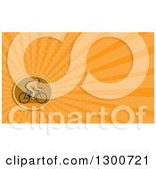 Clipart Of A Retro Silhouetted Cyclist In Profile And Orange Rays Background Or Business Card Design Royalty Free Illustration