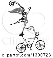 Clipart Of A Black And White Woodcut Circus Act Woman Balancing On A Bicycle Royalty Free Vector Illustration