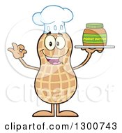 Clipart Of A Happy Chef Peanut Mascot Character Gesturing Ok And Holding A Jar Of Butter Royalty Free Vector Illustration