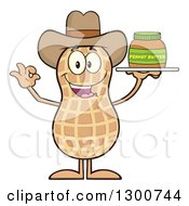 Clipart Of A Happy Cowboy Peanut Mascot Character Gesturing Ok And Holding A Jar Of Butter Royalty Free Vector Illustration