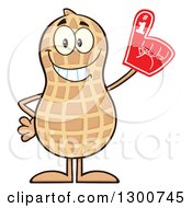 Clipart Of A Happy Peanut Mascot Character Wearing A Foam Finger Royalty Free Vector Illustration by Hit Toon