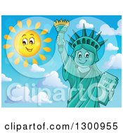 Clipart Of A Carton Happy Statue Of Liberty Holding Up A Torch Against Blue Sky With A Sun Smiling And Puffy Clouds Royalty Free Vector Illustration by visekart