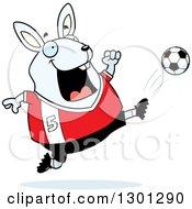 Clipart Of A Cartoon Chubby White Rabbit Kicking A Soccer Ball Royalty Free Vector Illustration