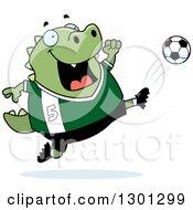 Clipart Of A Cartoon Chubby Lizard Kicking A Soccer Ball Royalty Free Vector Illustration