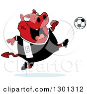 Clipart Of A Cartoon Chubby Red Devil Kicking A Soccer Ball Royalty Free Vector Illustration