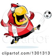 Clipart Of A Cartoon Chubby Red Cardinal Bird Kicking A Soccer Ball Royalty Free Vector Illustration