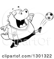 Outline Clipart Of A Cartoon Black And White Chubby Lizard Kicking A Soccer Ball Royalty Free Lineart Vector Illustration by Cory Thoman