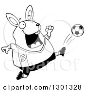 Outline Clipart Of A Cartoon Black And White Chubby Rabbit Kicking A Soccer Ball Royalty Free Lineart Vector Illustration