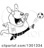 Outline Clipart Of A Cartoon Black And White Chubby Wallaby Kicking A Soccer Ball Royalty Free Lineart Vector Illustration by Cory Thoman
