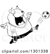 Outline Clipart Of A Cartoon Black And White Chubby Hamster Kicking A Soccer Ball Royalty Free Lineart Vector Illustration