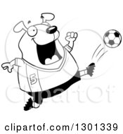 Outline Clipart Of A Cartoon Black And White Chubby Dog Kicking A Soccer Ball Royalty Free Lineart Vector Illustration