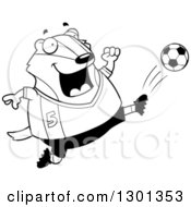 Outline Clipart Of A Cartoon Black And White Chubby Badger Kicking A Soccer Ball Royalty Free Lineart Vector Illustration by Cory Thoman
