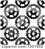 Clipart Of A Seamless Background Pattern Of Grayscale Gear Cogs 4 Royalty Free Vector Illustration