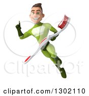 Clipart Of A 3d Young Brunette White Male Super Hero Dentist In A Green Suit Holding Up A Finger And Flying With A Giant Toothbrush Royalty Free Illustration