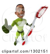 Clipart Of A 3d Young Black Male Dentist Super Hero In A Green Suit Holding Up A Giant Toothbrush And A Thumb Up Royalty Free Illustration