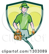 Cartoon White Male Gardner Using A Leaf Blower And Emerging From A Green And White Shield