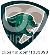 Clipart Of A Growling Green Black Panther Cat In A Shield Royalty Free Vector Illustration by patrimonio