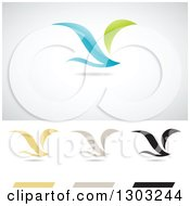 Clipart Of Flying Birds Or Wings Logos With Shadows Royalty Free Vector Illustration by cidepix