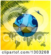 Clipart Of A Blue Earth Globe With Sunglasses Over A Map With An Airplane And Palm Branches On Yellow Royalty Free Vector Illustration by elaineitalia