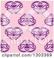 Clipart Of A Seamless Pattern Background Of Ornate Purple Flowers Royalty Free Vector Illustration