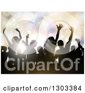 Clipart Of Silhouetted Dancers In A Crowd Against Flares And Pastel Lights Royalty Free Vector Illustration by KJ Pargeter