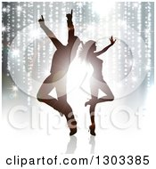 Clipart Of Silhouetted Dancing Couple Against Flares And Trailing Lights Royalty Free Vector Illustration