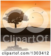 Clipart Of A Silhouetted Tree And Hills With Flying Birds Reflecting In Water Against An Orange Sunset Royalty Free Vector Illustration