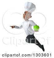 3d Young Black Male Super Chef Flying Pointing And Holding A Green Apple
