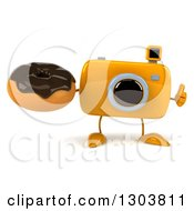 Clipart Of A 3d Yellow Camera Character Giving A Thumb Up And Holding A Chocolate Frosted Donut Royalty Free Illustration by Julos
