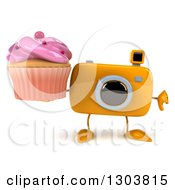 Clipart Of A 3d Yellow Camera Character Holding A Pink Frosted Cupcake And Thumb Down Royalty Free Illustration by Julos