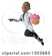 Clipart Of A 3d Young Black Male Doctor Flying Pointing To The Left And Holding A Pink Frosted Cupcake Royalty Free Illustration