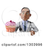 Clipart Of A 3d Unhappy Young Black Male Doctor Holding A Pink Frosted Cupcake Over A Sign Royalty Free Illustration