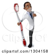 Clipart Of A 3d Full Length Young Black Male Dentist Holding A Giant Toothbrush Around A Sign Royalty Free Illustration