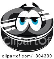 Clipart Of A Hockey Puck Character With Blue Eyes 2 Royalty Free Vector Illustration