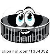 Clipart Of A Hockey Puck Character With Blue Eyes Royalty Free Vector Illustration