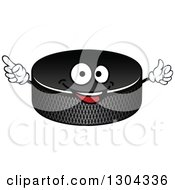 Clipart Of A Hockey Puck Character Holding Up A Finger Royalty Free Vector Illustration