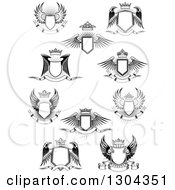 Clipart Of Black And White Winged Shields Banners And Crowns Over Bursts Royalty Free Vector Illustration