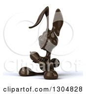 Clipart Of A 3d Dark Chocolate Easter Bunny Rabbit Holding A Carrot And Facing Slightly Left Royalty Free Illustration by Julos