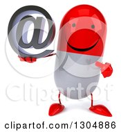 Clipart Of A 3d Happy Red And White Pill Character Holding And Pointing To An Email Arobase At Symbol Royalty Free Illustration